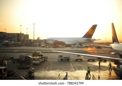 Frankfurt/Main, Germany - 11 16 2011: Lufthansa Airplanes at the Gates of Frankfurt Internatinal Airport at Dawn with golden Sunlight