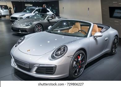 Frankfurt-September 20:  Porsche 911 Carrera S, Porsche 718 Boxster S and Porsche Macan Turbo at the Frankfurt International Motor Show on September 20, 2017 in Frankfurt