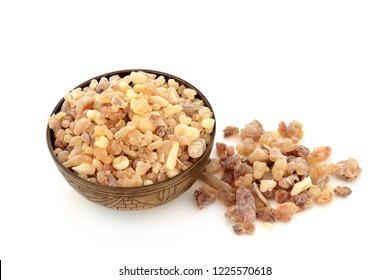 Frankincense aromatic gum resin in an old metal bowl and loose on white background. Used in perfumery and aromatherapy industries. Olibanum.