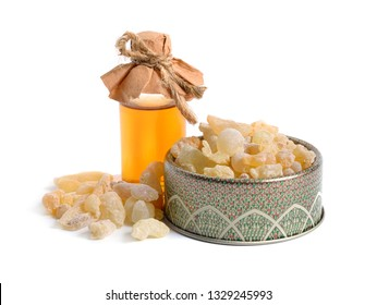 Frankincense essential oil, also known as olibanum, Hebrew is an aromatic resin used in incense and perfumes, obtained from trees of the genus Boswellia. isolated on white.