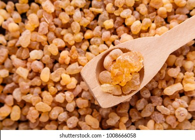 frankincense essential oil on a wooden background
