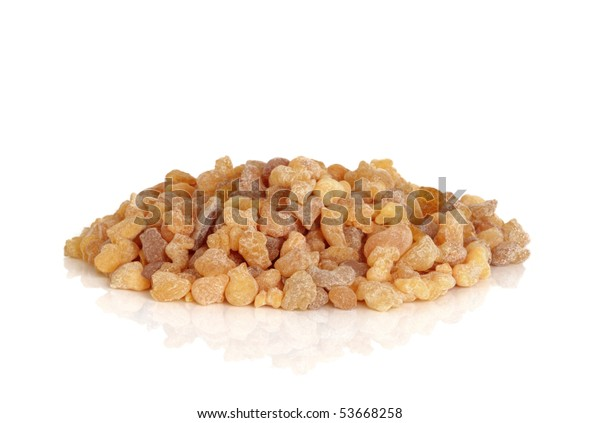Frankincense olibanum resin  isolated over white,background with reflection.