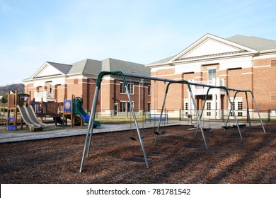 FRANKLIN, TENNESSEE-DECEMBER 26, 2017:  Playground equipment at an elementary school featuring swings and slides.