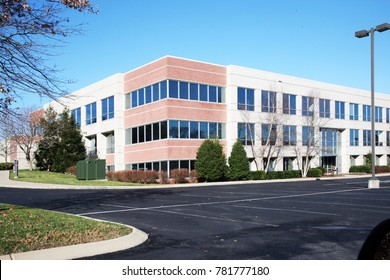 FRANKLIN, TENNESSEE-DECEMBER 26, 2017:  Three story office building with an empty parking lot on a suburban location.