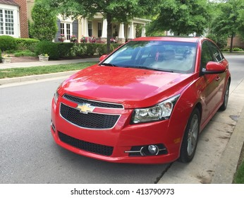 FRANKLIN, TN-APRIL 30, 2016:  New Chevrolet Cruze parked on a street with executive style luxury homes in the background.