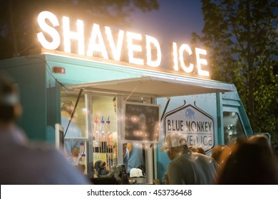 FRANKLIN, TN/USA - MAY 6, 2016: Festival-goers browse at Blue Monkey, a food truck offering shaved ice at Franklin's Eat the Street food truck festival.