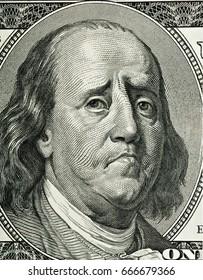 Franklin's cartoon portrait, similar to a portrait on one hundred dollar bill obverse