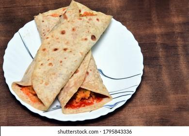 franky eat with schezwan chutni.  - Shutterstock ID 1795843336
