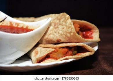 Franky with schezwan  Chutni. Roll Chapati. - Shutterstock ID 1795850863
