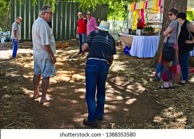 Franschhoek, South Africa - Circa 2018: People playing boules at an arts and crafts market.