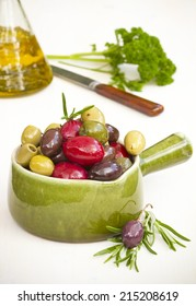 Franse , Italian , Greek colorful olives with herbs in a bowl and white background