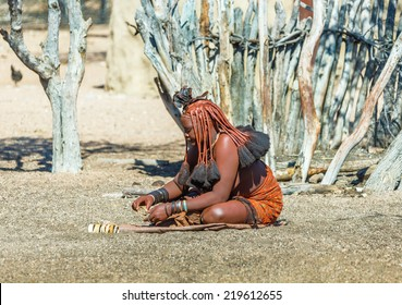 FRANSFONTEIN, NAMIBIA - JULY 09, 2014: A young woman Himba tribe. The Himba are indigenous peoples living in northern Namibia, in the Kunene region of South-West Africa