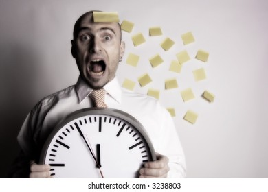 Frantic, unorganized businessman unsuccessfully tries to use many post-it notes to remind him of his busy schedule and appointments.