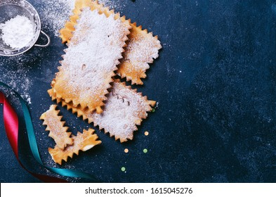 Frappe or chiacchiere  - typical Italian carnival fritters duste
