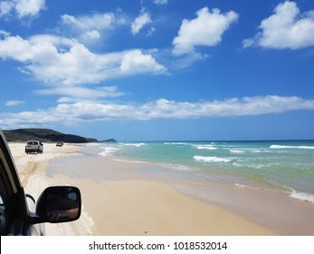 Fraser Island, Queensland, Australia, a photo taken from 4WD while driving on the beach during the low tide. Outdoor activity, amazing adventure, going from soft sand to hard sand and avoiding waves.