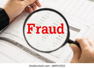 Fraud concept. financial statement, spreadsheet accounting and magnifying glass with business fraud investigation.