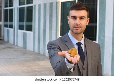 Fraudulent businessman offering some bullshit