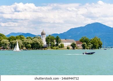 Fraueninsel, Frauenchiemsee on lake Chiemsee with boat, Sailboat, church, monastery. Bavaria, Bayern, Germany