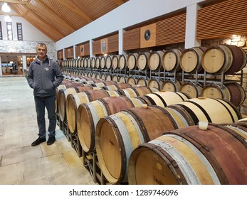 Frauenkirchen, Burgenland, Austria, 12.17.2017: the owner shows his winery Umathurn