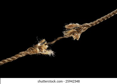 Frayed rope about to break isolated over black background