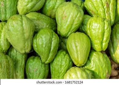 Freah chayote or Sechium edule on market for sale.Freah chayote background.Is a very useful vegetable.