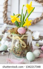 Freah daffodils and colorful eggs for a happy easter