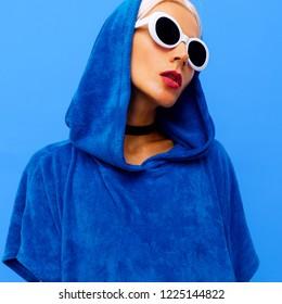 Freak Girl. Urban minimal style. Hoody and fashionable sunglasses