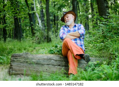 Freak healer. Folk magic. Person purported magical abilities. Magician in forest. Woodman magician concept. Mature man with beard in hat. Wise old man. Herbal remedies. Supernatural or superstitious.