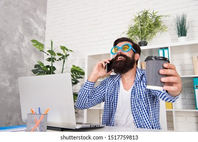 Freak managing projects. Emotional and mental composition of high performers. Office freak. Weirdo at workplace. Man freak crazy office manager having phone call while drinking coffee. Productive day.