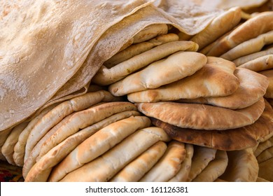 Freashly baked Khubz and Pide, typical arab flatbreads