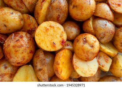 Frech potatoes cut in half and marinated with rosemary and paprika. Beautiful food background