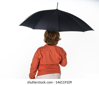 Freckled red-hair boy with umbrella. Isolated on white background.