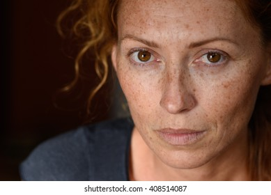 freckled young woman without make up close up