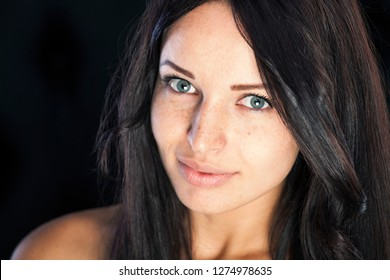 Freckles all over girls face. Portrait shot without any make up.