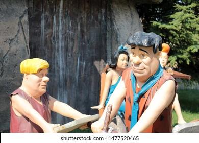 Fred Flintstone and Wilma Flintstone, Theme park of 80 Binde Devr-i Alem Parki Konya. Flintstone family. Konya - Turkey. August 2019.
