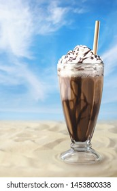 Freddo coffee with whipped cream on the beach, holidays