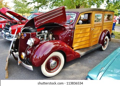 FREDERICK, MD- SEPTEMBER 16: 1936 Red Ford Woody Wagon on September, 2012 in Frederick , MD USA. Alzheimer's Association Benefit Car Show at Motor Vehicle Administration in Maryland.