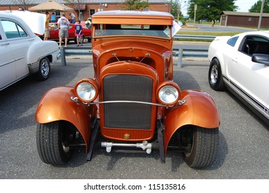 FREDERICK, MD- SEPTEMBER 16: 1936 Orange Ford Classic Car on Sept. 16, 2012 in Frederick , MD USA. Alzheimer's Association Benefit Car Show at Motor Vehicle Administration in Maryland.