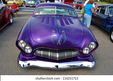 FREDERICK, MD -SEPTEMBER 16: 1950 Purple Ford Coupe Frontal Design Detail at a Car Show on September 16, 2012 in Frederick, MD USA. A Alzheimer's Benefit Car Show in Maryland.
