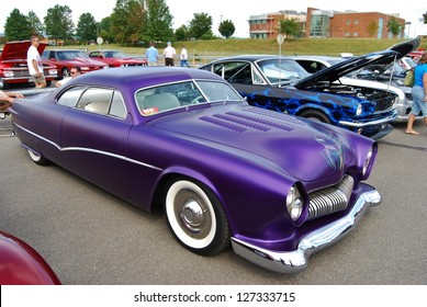FREDERICK, MD - SEPTEMBER 16 : 1950 Purple Ford Coupe Frontal Design Detail at a Car Show on September 16, 2012 in Frederick, MD USA. A Alzheimer's Benefit Car Show to fund research in Maryland.