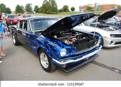 FREDERICK, MD- SEPTEMBER 16: 1970 Airbrushed Blue Ford Mustang on Sept. 16, 2012 in Frederick , MD USA. Alzheimer's Association Benefit Car Show at Motor Vehicle Administration in Maryland.