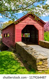 Frederick, MD, USA - April 26, 2015: Covered bridge for foot traffic in  Baker Park, in Frederick, Maryland.