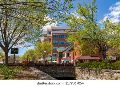 Frederick, MD, USA - April 26, 2015: Walking areas at the Carroll Creek Promenade Creekside floodplain development features footpaths, fountains & planted areas is located in the downtown.