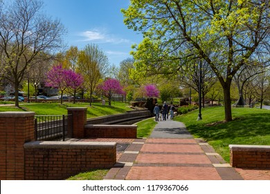 Frederick, MD, USA - April 26, 2015: The Carroll Creek Promenade Creekside floodplain development with brick footpaths, fountains & planted areas is located in downtown Frederick.