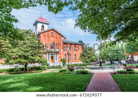 Frederick, USA - May 24, 2017: City Hall in downtown city in Maryland with brick building exterior, sign
