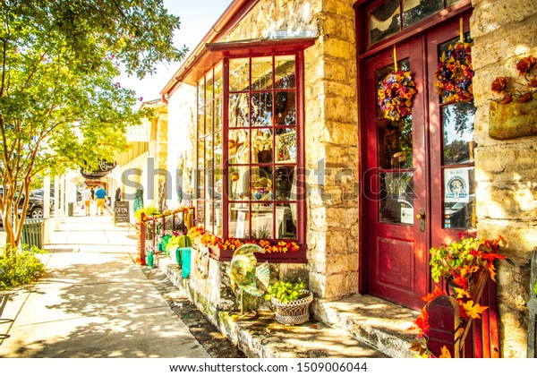 """Fredericksburg, Texas, USA-07 September 2019 : The Main Street in Frederiksburg, Texas, also known as """"The Magic Mile"""", with retail stores and poeple walking"""