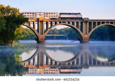 FREDERICKSBURG, VIRGINIA - OCTOBER 1, 2009: An early morning Virgina Railway Express commuter train passes over the Rappahannock River en route to Washington, D.C.