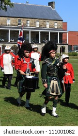 FREDERICTON, NB, CANADA - CIRCA AUGUST 2012 - The Changing of the Guard Ceremony at Officer's Square  where period guards re-enact a drill ceremony focusing on the piper and drummer circa August 2012