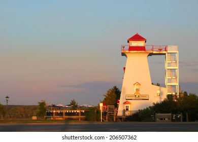 FREDERICTON, NEW BRUNSWICK, JULY 22, 2014: Lighthouse on the Green, a popular tourist spot on the waterfront in Fredericton at sunset, New Brunswick, Maritimes, Atlantic Canada