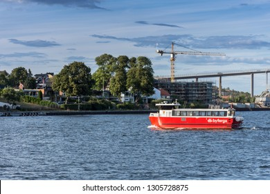 Fredrikstad, Norway - August 04 2018: Red passenger ferry boat crossing the river, in Fredrikstad